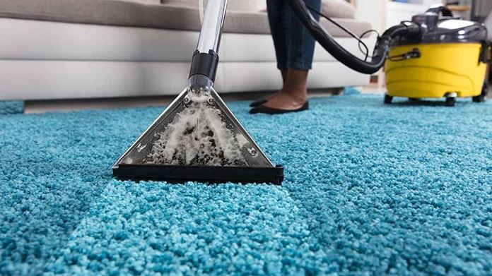 person using an at home carpet cleaner